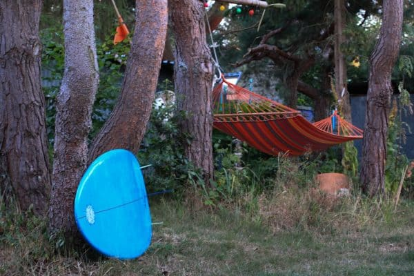 Blue Surfboard and Red Hammock