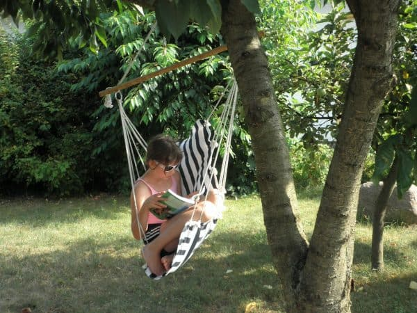 Child Reading on a Seat Swing