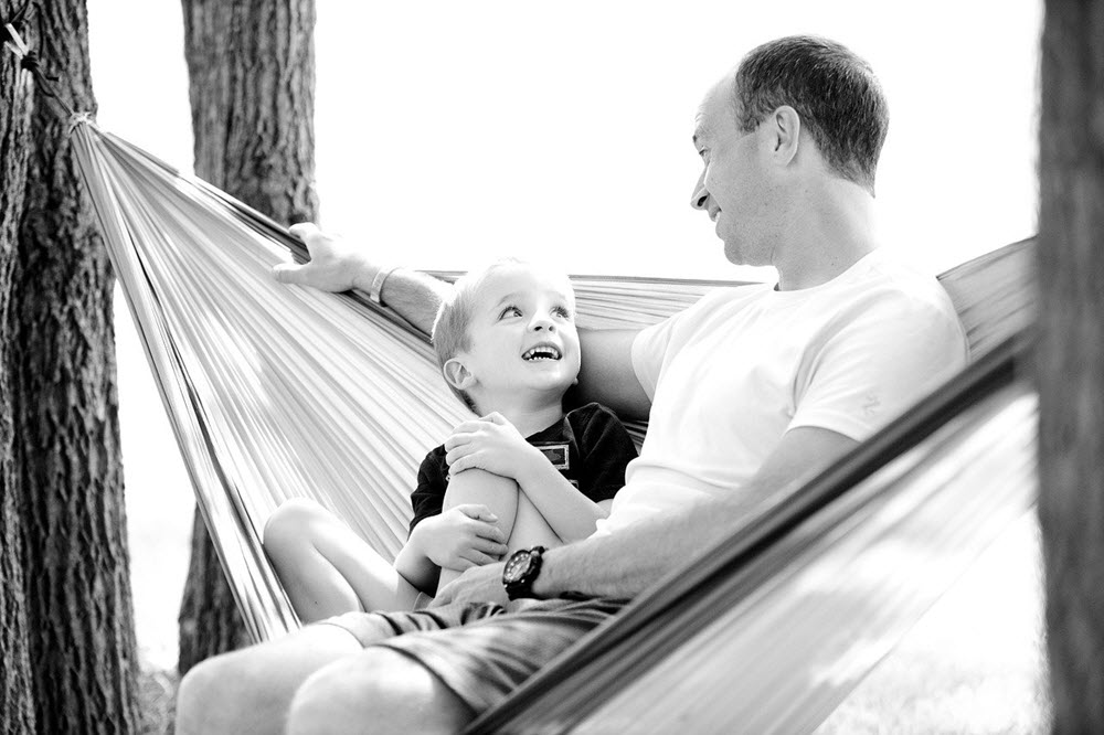 father and son in double hammock